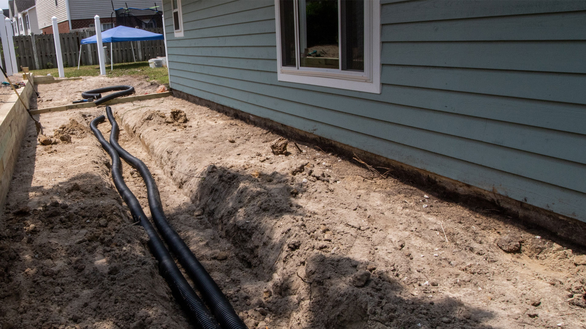 Grading and drainage installation for a new landscape project in Thibodaux.