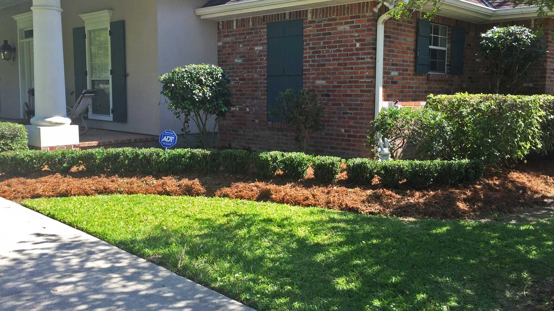 Beautifully maintained landscaping with new mulch at a residential property.