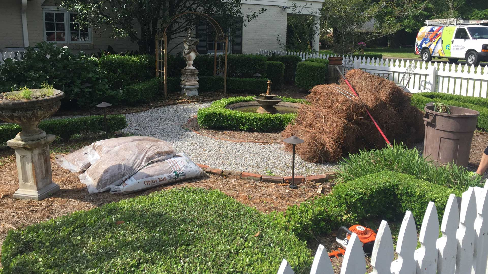 Lafourche Lawn & Farm employees laying new sod and mulch at a home in Thibodaux. Start your new career with our team today!