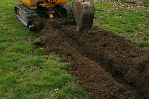 Digging a trench for drainage at a home in Raceland.